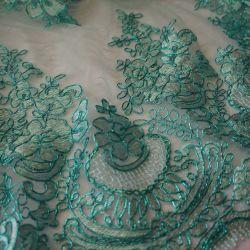 Гипюр на сетке бирюзового цвета с бирюзовой нитью